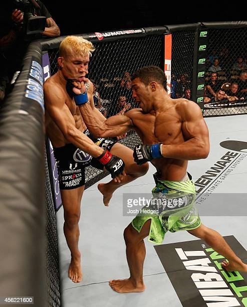 Kevin Lee punches Jon Tuck in their lightweight fight during the UFC 178 event inside the MGM Grand Garden Arena on September 27 2014 in Las Vegas...