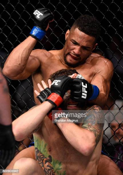 Kevin Lee punches Michael Chiesa in their lightweight bout during the UFC Fight Night event at the Chesapeake Energy Arena on June 25 2017 in...