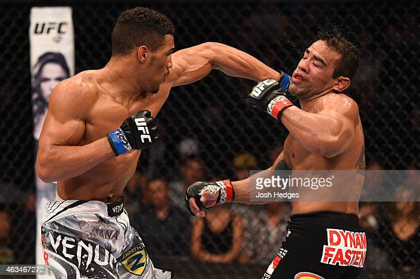Kevin Lee punches Michel Prazeres in their lightweight fight during the UFC Fight Night event inside 1stBank Center on February 14 2015 in Broomfield...