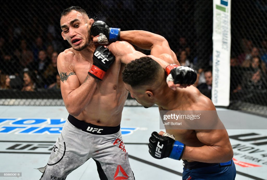 Kevin Lee punches Tony Ferguson in their interim UFC lightweight championship bout during the UFC 216 event inside T-Mobile Arena on October 7, 2017 in Las Vegas, Nevada.