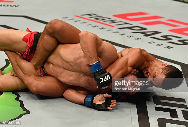 Kevin Lee secures a rear choke submission against Magomed Mustafaev of Russia in their lightweight bout during the UFC Fight Night at the SSE Arena...