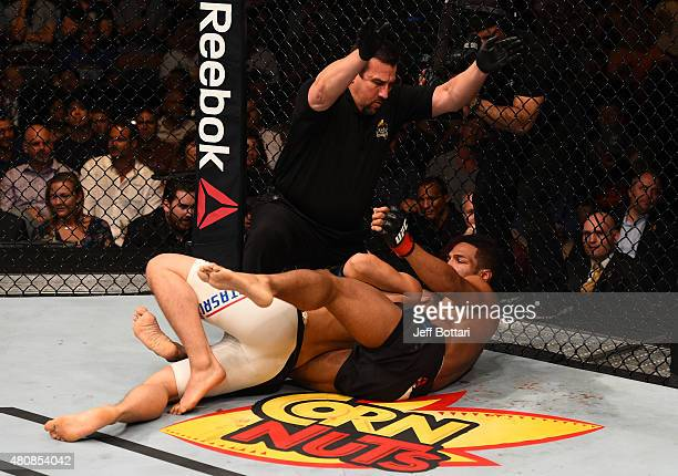 Kevin Lee submits James Moontasri in their lightweight bout during the UFC event at the Valley View Casino Center on July 15 2015 in San Diego...