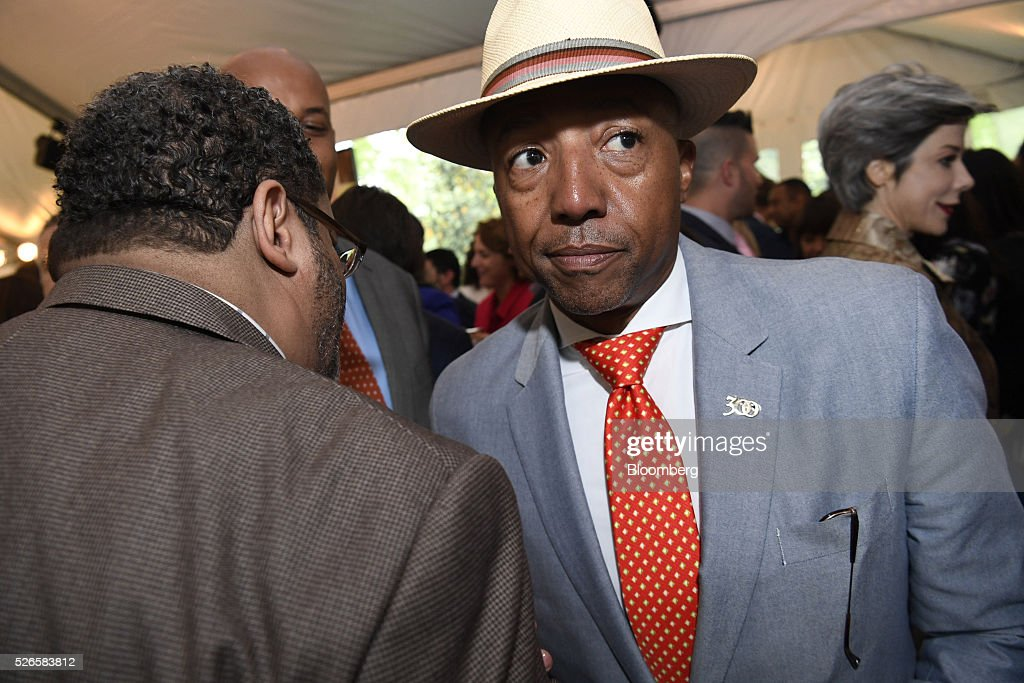 Russell Simmons, chairman and chief executive officer of Rush Communications, right, attends the 23rd Annual White House Correspondents' Garden Brunch in Washington, D.C., U.S., on Saturday, April 30, 2016. The event will raise awareness for Halcyon Incubator, an organization that supports early stage social entrepreneurs 'seeking to change the world' through an immersive 18-month fellowship program. Photographer: David Paul Morris/Bloomberg via Getty Images