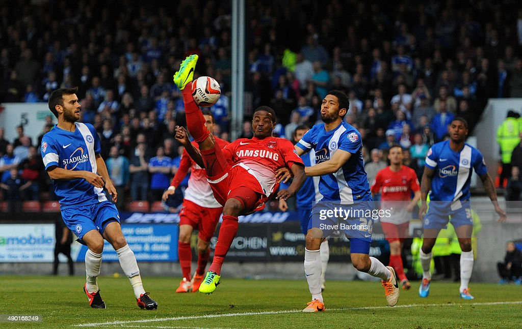 <a gi-track='captionPersonalityLinkClicked' href=/galleries/search?phrase=Kevin+Lisbie&family=editorial&specificpeople=226902 ng-click='$event.stopPropagation()'>Kevin Lisbie</a> of Leyton Orient challenges for the ball with Nathaniel Knight-Percival of Peterborough United during the Sky Bet League One play-off semi-final second leg match between Leyton Orient and Peterborough United at Matchroom Stadium on May 13, 2014 in London, England.