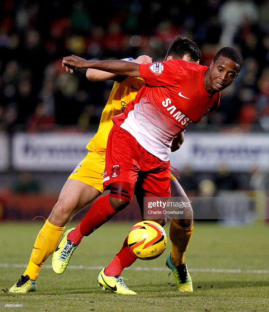 <a gi-track='captionPersonalityLinkClicked' href=/galleries/search?phrase=Kevin+Lisbie&family=editorial&specificpeople=226902 ng-click='$event.stopPropagation()'>Kevin Lisbie</a> of Leyton Orient holds off a defender during the Sky Bet League One match between Leyton Orient and Preston North End at The Matchroom Stadium on November 16, 2013 in London, England.