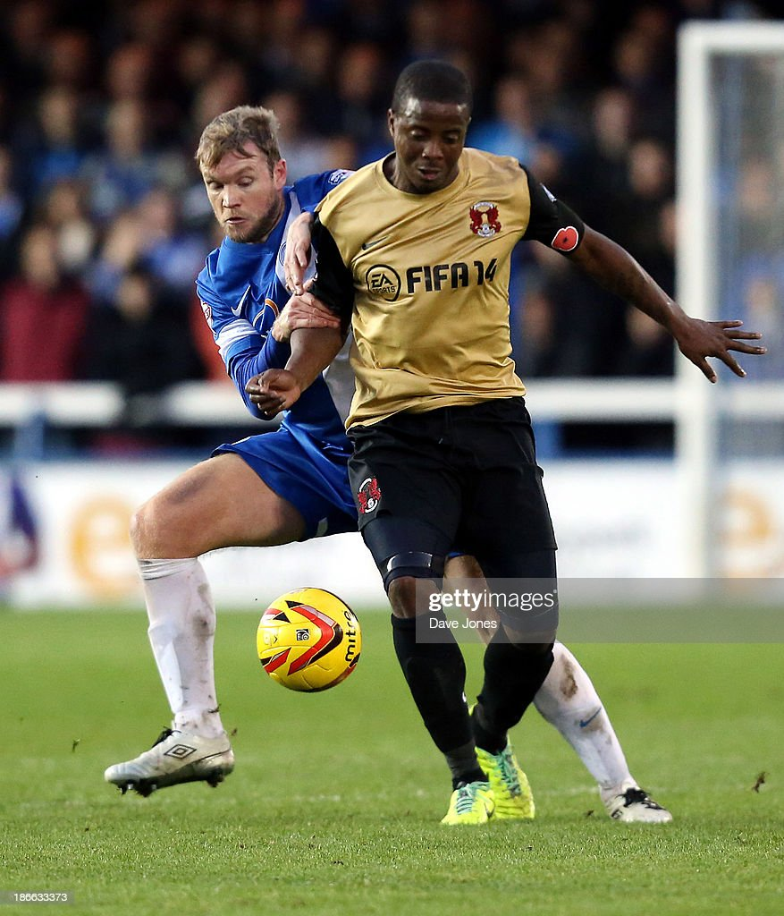 <a gi-track='captionPersonalityLinkClicked' href=/galleries/search?phrase=Kevin+Lisbie&family=editorial&specificpeople=226902 ng-click='$event.stopPropagation()'>Kevin Lisbie</a> of Leyton Orient holds off Grant McCann of Peterborough United during the Sky Bet League One match between Peterborough United and Leyton Orient at London Road Stadium on November 02, 2013 in Peterborough, England.