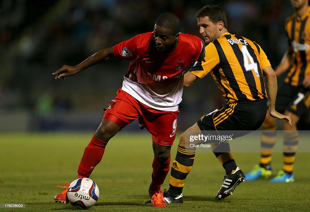<a gi-track='captionPersonalityLinkClicked' href=/galleries/search?phrase=Kevin+Lisbie&family=editorial&specificpeople=226902 ng-click='$event.stopPropagation()'>Kevin Lisbie</a> (L) of Leyton Orient is challenged by <a gi-track='captionPersonalityLinkClicked' href=/galleries/search?phrase=Alex+Bruce+-+Soccer+Player+-+Born+1984&family=editorial&specificpeople=12317845 ng-click='$event.stopPropagation()'>Alex Bruce</a> of Hull City during the Capital One cup second round match between Leyton Orient and Hull City at Matchroom Stadium on August 27, 2013 in London, England.