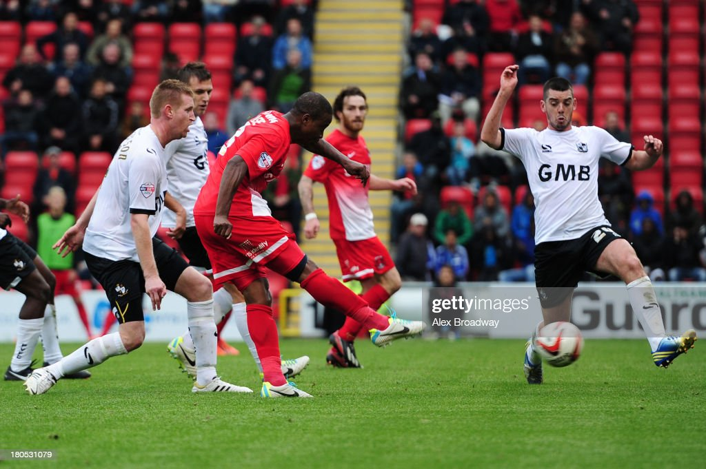 <a gi-track='captionPersonalityLinkClicked' href=/galleries/search?phrase=Kevin+Lisbie&family=editorial&specificpeople=226902 ng-click='$event.stopPropagation()'>Kevin Lisbie</a> (C) of Leyton Orient scores the winning goal during the Sky Bet League One match between Leyton Orient and Port Vale at Brisbane Road on September 14, 2013 in London, England.