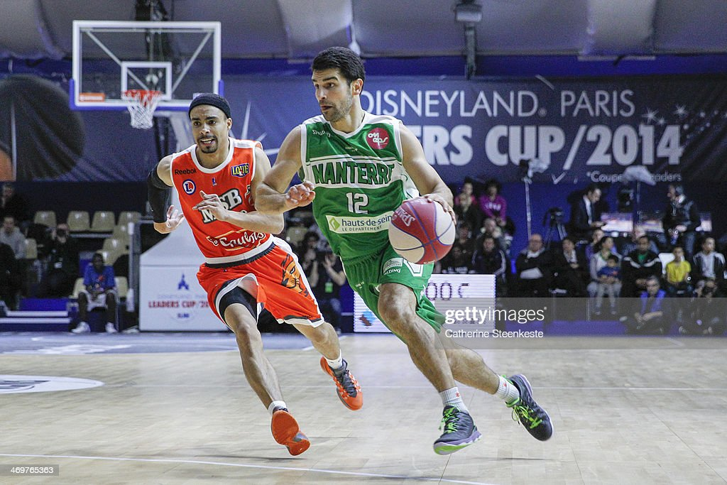 Kevin Lisch of Nanterre is trying to go to the basket against DaShaun Wood of Le Mans during the game between Le Mans and Nanterre at Disney Events...