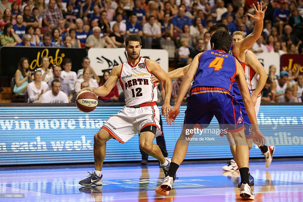 Kevin Lisch of Perth runs with the ball during the round ten NBL match between the Adelaide 36ers and the Perth Wildcats at Adelaide Arena on December 9, 2012 in Adelaide, Australia.