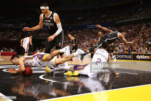Kevin Lisch of the Kings dives on the ball during the round 18 NBL match between the Sydney Kings and Melbourne United at Qudos Bank Arena on...