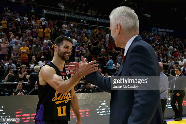 Kevin Lisch of the Kings is congratulated by Head coach Andrew Gaze during the round five NBL match between the Sydney Kings and the Cairns Taipans...
