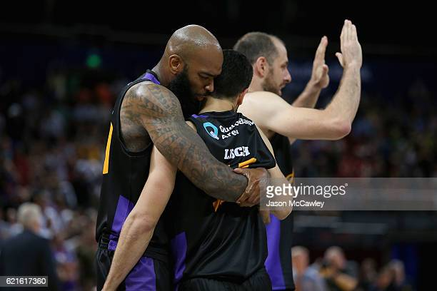 Kevin Lisch of the Kings is congratulated by Josh Powell during the round five NBL match between the Sydney Kings and the Cairns Taipans at Qudos...