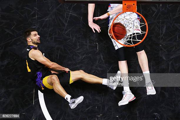 Kevin Lisch of the Kings is fouled by Matt Hodgson of the 36ers during the round eight NBL match between the Sydney Kings and the Adelaide 36ers at...