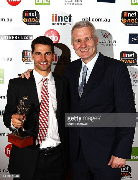 Kevin Lisch of the Perth Wildcats is presented with the Andrew Gaze trophy for the NBL Most Valuable Player by Andrew Gaze during the 2012 Basketball...