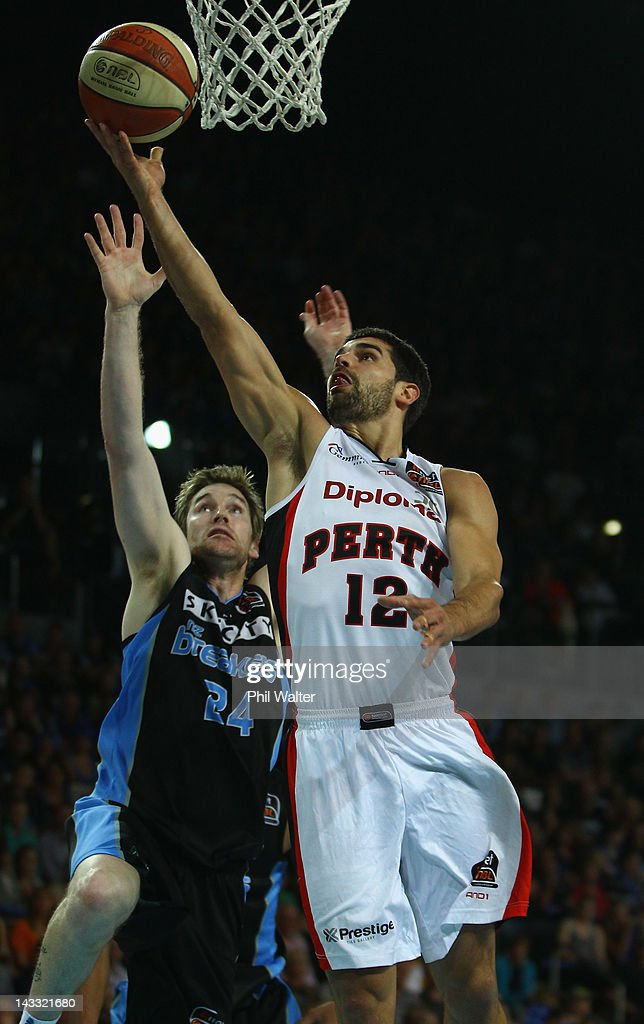 Kevin Lisch of the Wildcats and Dillon Boucher of the Breakers contest the ball during game three of the NBL Grand Final series between the New...