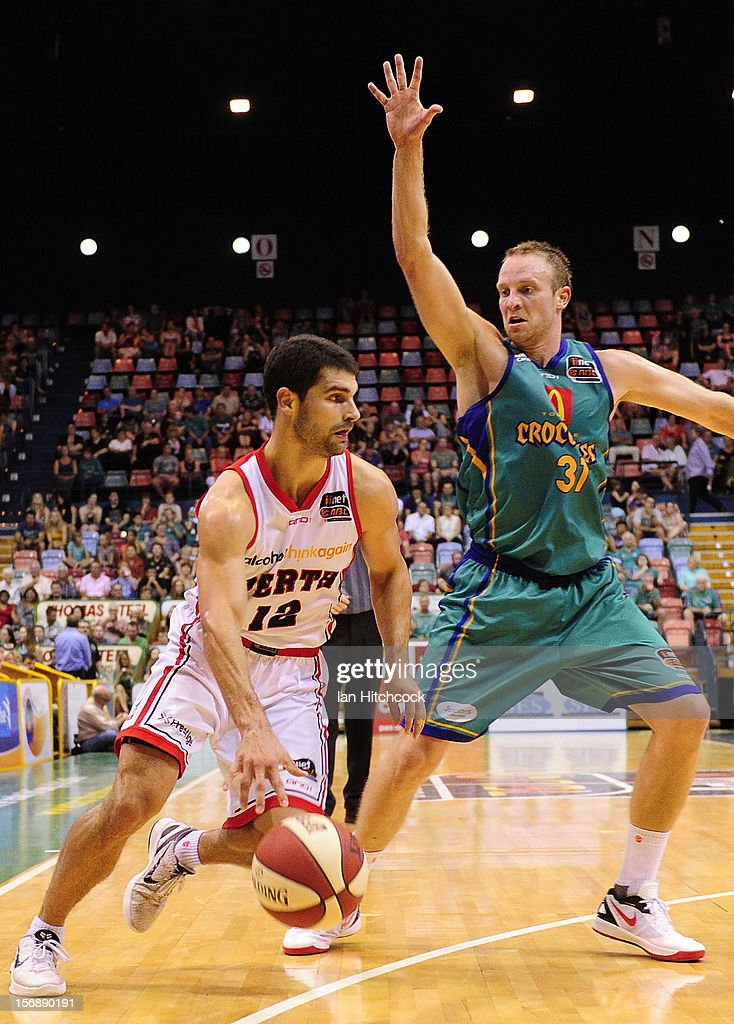 Kevin Lisch of the Wildcats attempts to drive past Jacob Holmes of the Crocodiles during the round eight NBL match between the Townsville Crocodiles and the Perth Wildcats at Townsville Entertainment Centre on November 24, 2012 in Townsville, Australia.
