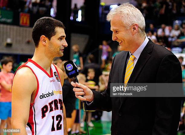 Kevin Lisch of the Wildcats does an interview with Andrew Gaze after winning the round two NBL match between the Townsville Crocodiles and the Perth...