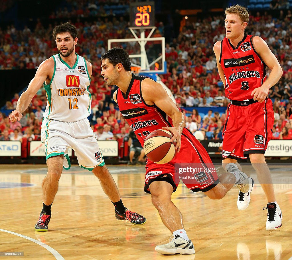 Kevin Lisch of the Wildcats drives into the keyway during the round 16 NBL match between the Perth Wildcats and the Townsville Crocodiles at Perth Arena on January 25, 2013 in Perth, Australia.