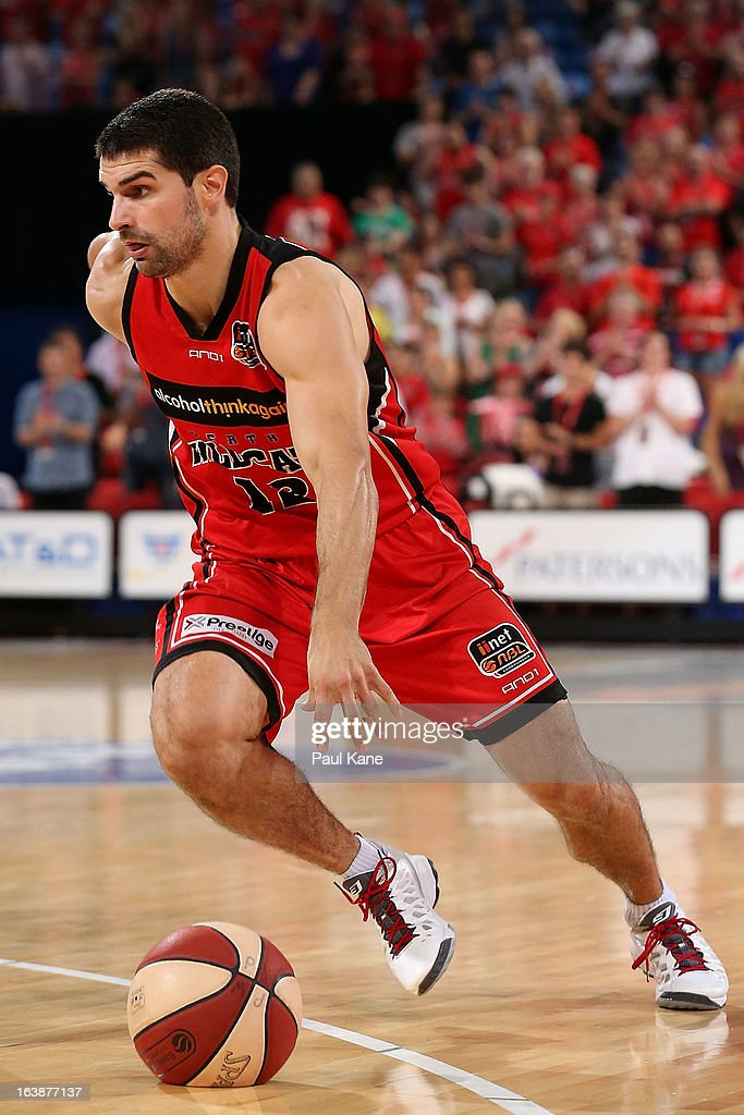 Kevin Lisch of the Wildcats drives towards the key during the round 23 NBL match between the Perth Wildcats and the Cairns Taipans at Perth Arena on March 17, 2013 in Perth, Australia.