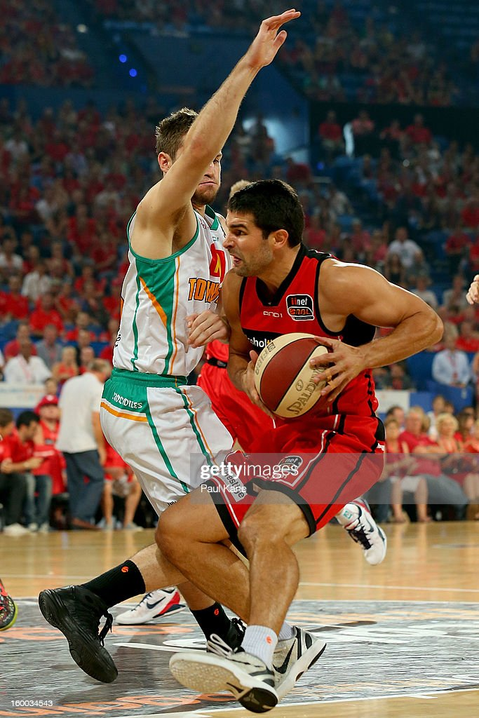 Kevin Lisch of the Wildcats is pulls up against Mitch Norton of the Crocodiles during the round 16 NBL match between the Perth Wildcats and the Townsville Crocodiles at Perth Arena on January 25, 2013 in Perth, Australia.