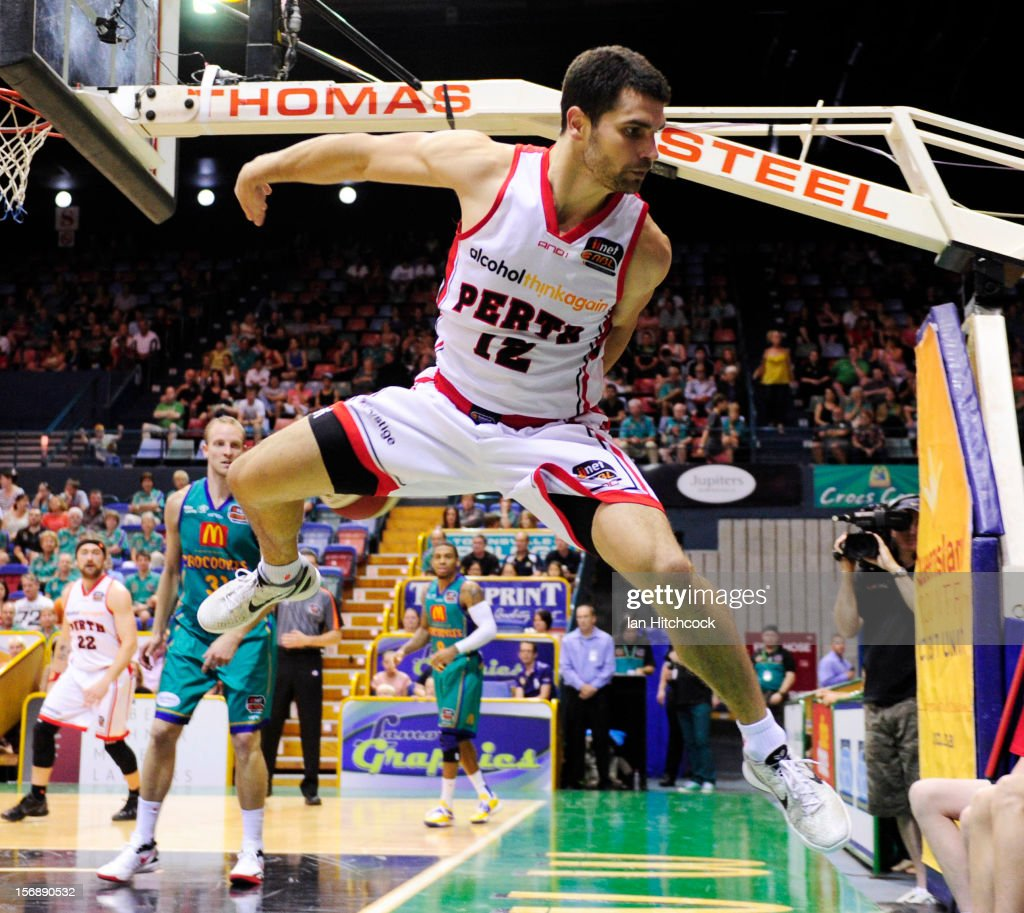 Kevin Lisch of the Wildcats jumps to regather an out of bounds ball during the round eight NBL match between the Townsville Crocodiles and the Perth Wildcats at Townsville Entertainment Centre on November 24, 2012 in Townsville, Australia.