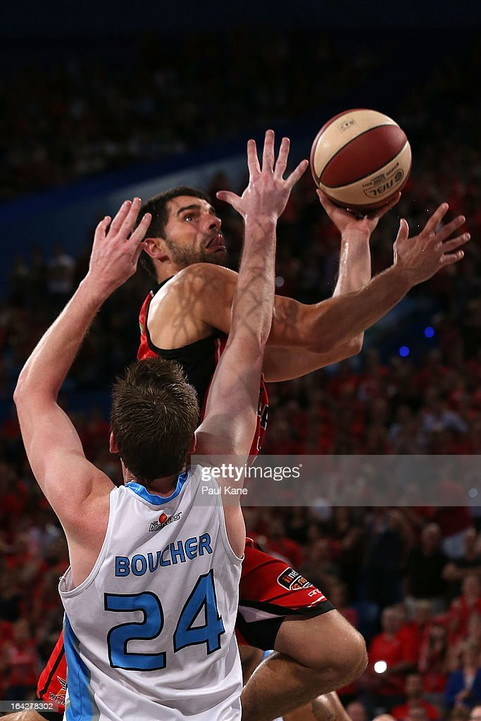Kevin Lisch of the Wildcats lays up against Dillon Boucher of the Breakers during the round 24 NBL match between the Perth Wildcats and the New...