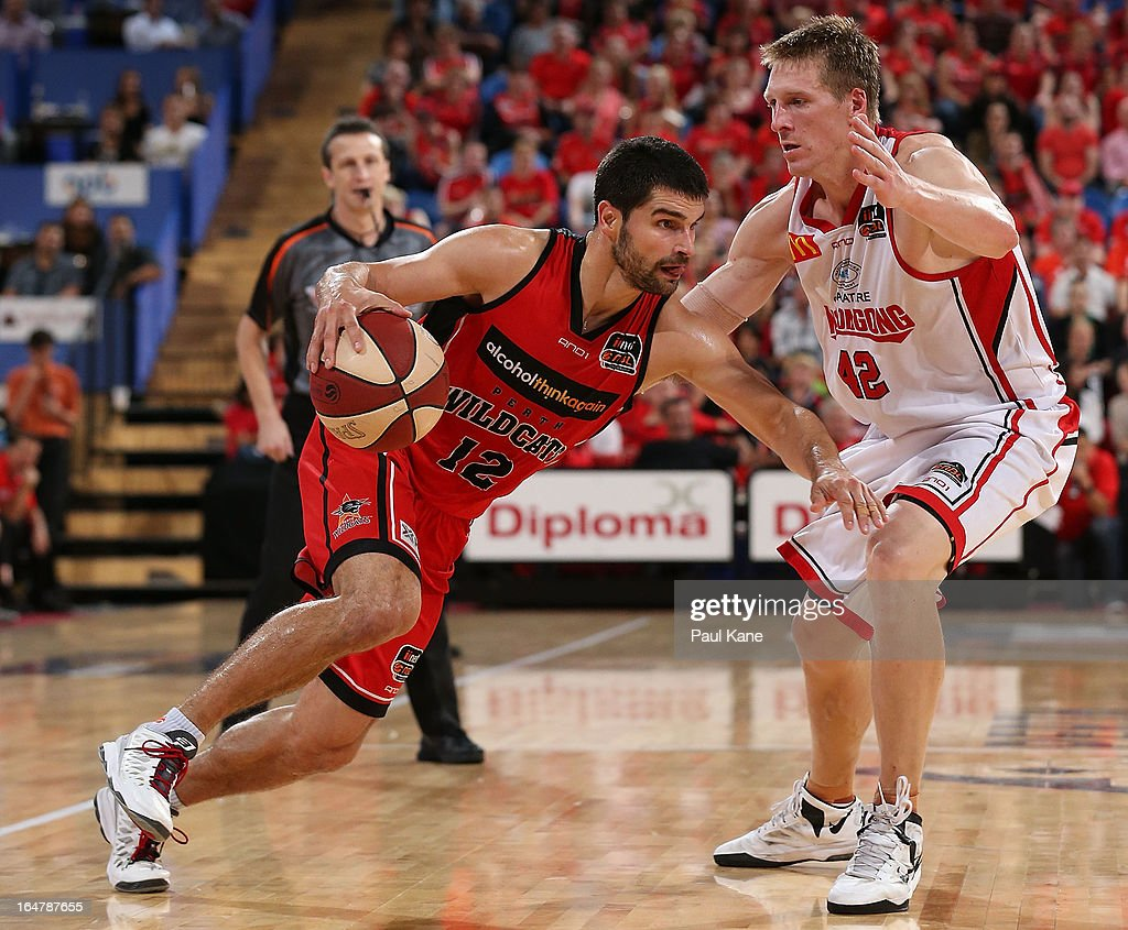 Kevin Lisch of the Wildcats looks to drive past David Gruber of the Hawks during game one of the NBL Semi Final Series between the Perth Wildcats and the Wollongong Hawks at Perth Arena on March 28, 2013 in Perth, Australia.