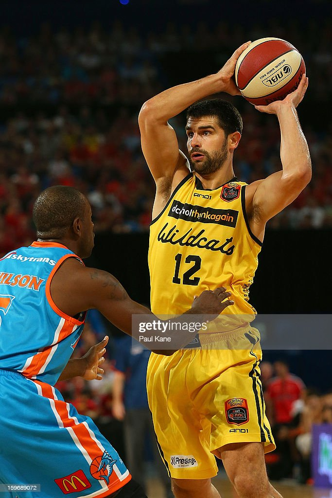 Kevin Lisch of the Wildcats looks to pass the ball against Jamar Wilson of the Taipans during the round 15 NBL match between the Perth Wildcats and the Cairns Taipans at Perth Arena on January 18, 2013 in Perth, Australia.