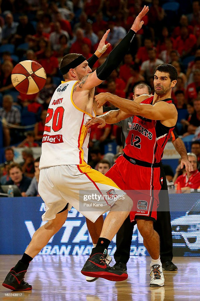 Kevin Lisch of the Wildcats passes the ball against Seth Scott of the Tigers during the round 20 NBL match between the Perth Wildcats and the Melbourne Tigers at Perth Arena on February 21, 2013 in Perth, Australia.