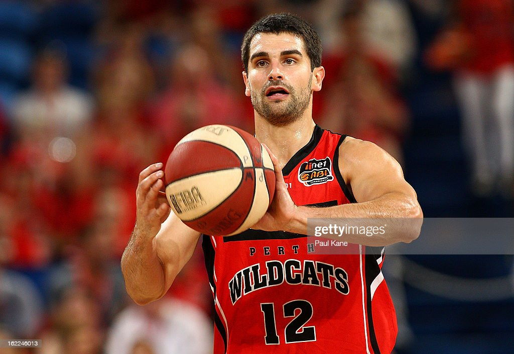 Kevin Lisch of the Wildcats passes the ball during the round 20 NBL match between the Perth Wildcats and the Melbourne Tigers at Perth Arena on February 21, 2013 in Perth, Australia.