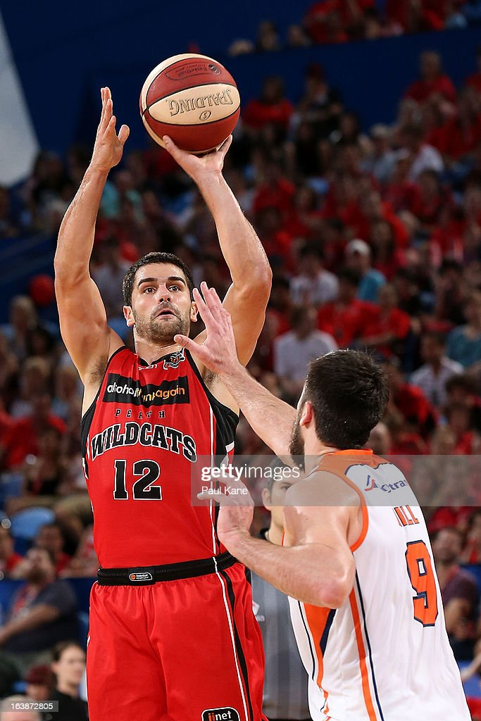 Kevin Lisch of the Wildcats shoots against Brad Hill of the Taipans during the round 23 NBL match between the Perth Wildcats and the Cairns Taipans at Perth Arena on March 17, 2013 in Perth, Australia.