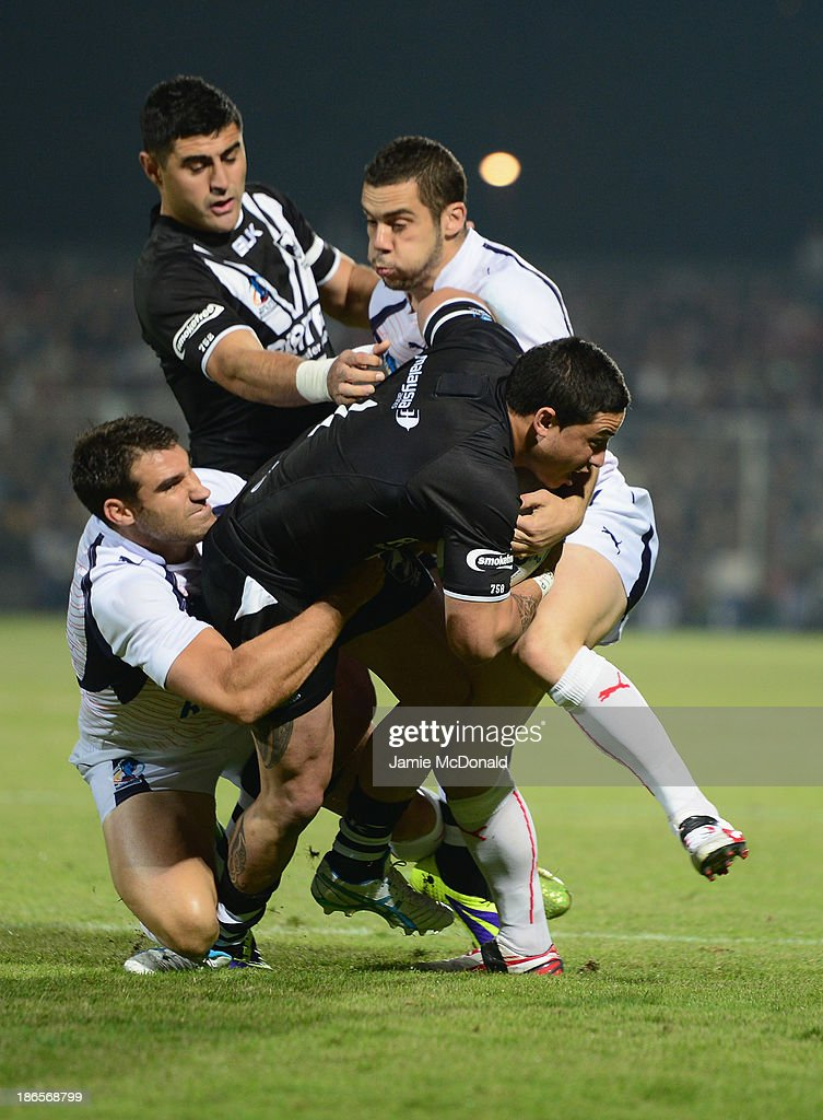 Kevin Locke of New Zealand is held up by Thomas Bosc of France during the Rugby League World Cup group B match between New Zealand and France at Parc des Sports on November 1, 2013 in Avignon, France.