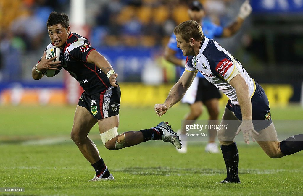 Kevin Locke of the Warriors steps Brent Tate of the Cowboys during the round four NRL match between the New Zealand Warriors and the North Queensland Cowboys at Mt Smart Stadium on April 1, 2013 in Auckland, New Zealand.