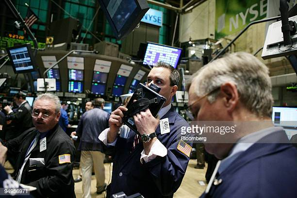Kevin Lodewick center works on the floor of the New York Stock Exchange in New York US on Monday April 6 2009 US stocks fell for the first time in...