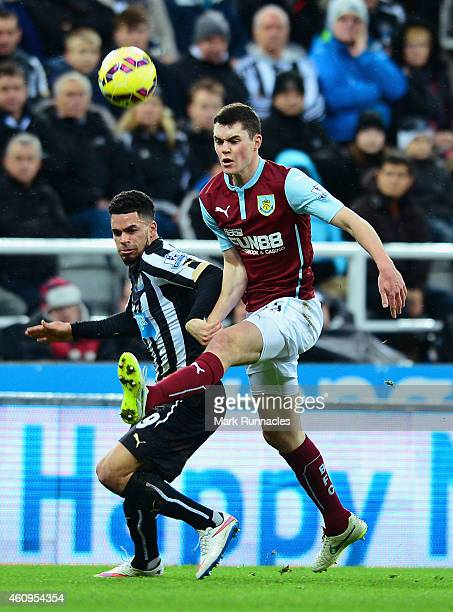 Kevin Long of Burnley and Emmanuel Riviere of Newcastle United battle for the ball during the Barclays Premier League match between Newcastle United...