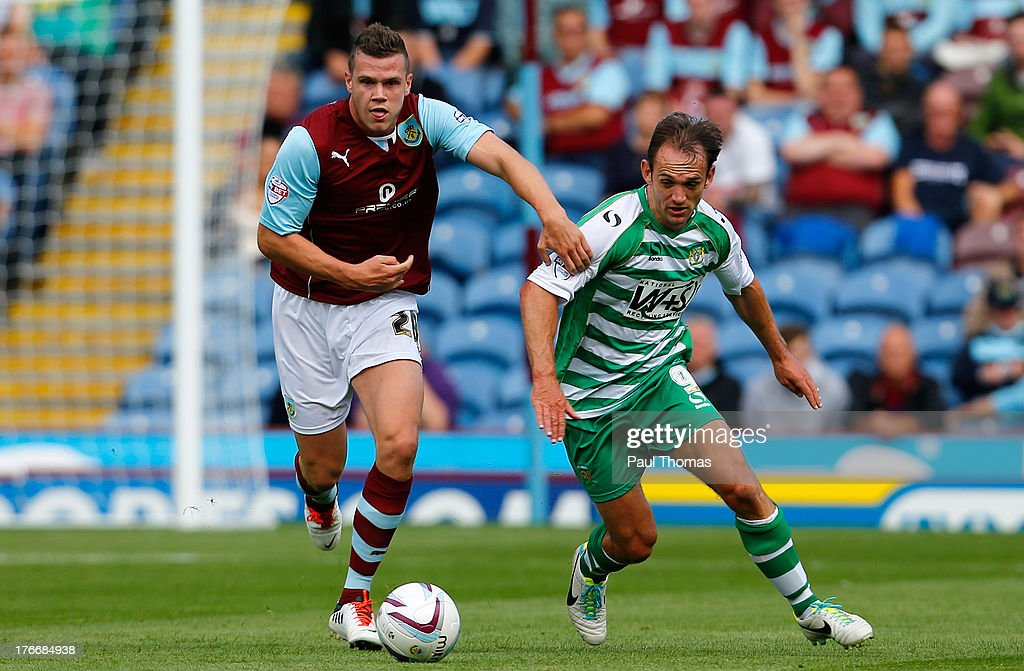 Kevin Long (L) of Burnley in action with James Hayter of Yeovil during the Sky Bet Championship match between Burnley and Yeovil Town at Turf Moor on August 17, 2013 in Burnley, England