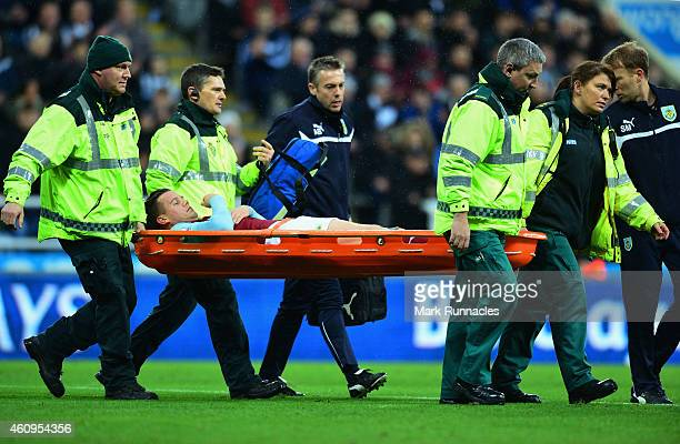 Kevin Long of Burnley is stretchered off injured during the Barclays Premier League match between Newcastle United and Burnley at St James' Park on...