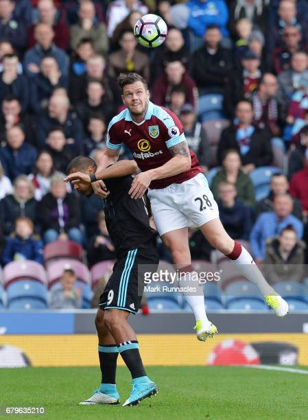 Kevin Long of Burnley outjumps Jose Salomon Rondon of West Bromwich Albion during the Premier League match between Burnley and West Bromwich Albion...