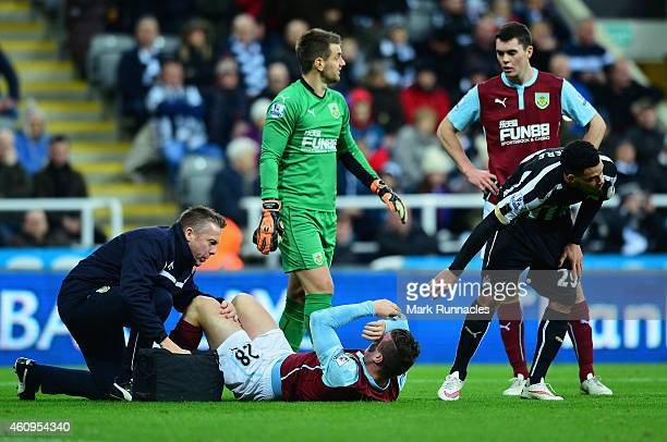 Kevin Long of Burnley receives treatment during the Barclays Premier League match between Newcastle United and Burnley at St James' Park on January 1...