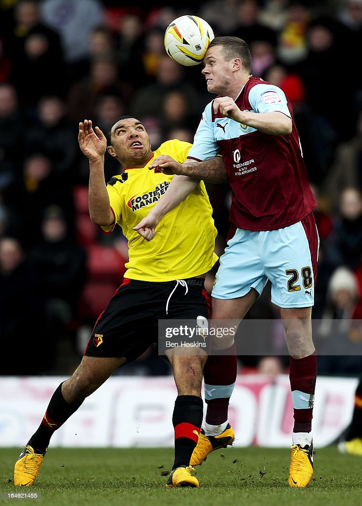 Kevin Long of Burnley wins an aerial ball whilst under pressure from Troy Deeney of Watford during the npower Championship match between Watford and Burnley at Vicarage Road on March 29, 2013 in Watford, England.