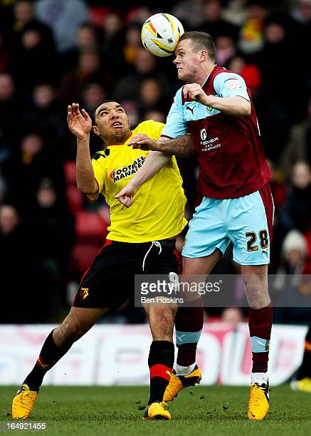 Kevin Long of Burnley wins an aerial ball whilst under pressure from Troy Deeney of Watford during the npower Championship match between Watford and...