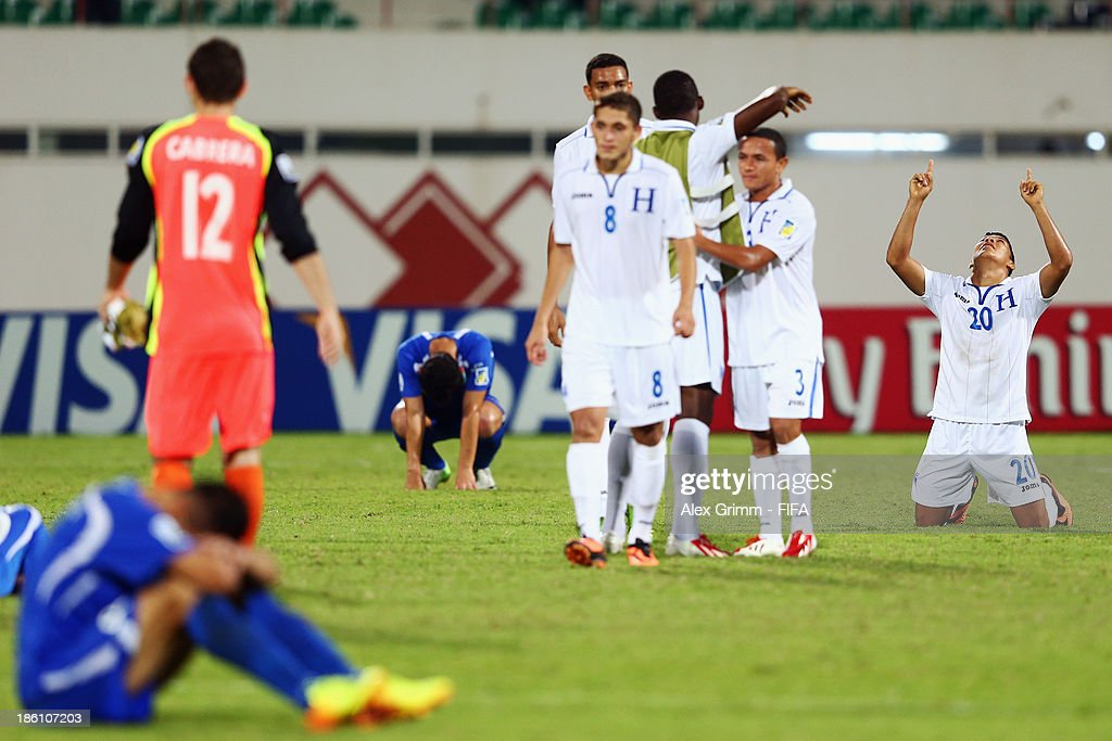 Kevin Lopez (R) of Honduras celebrates after the FIFA U-17 World Cup UAE 2013 Round of 16 match between Honduras and Uzbekistan at Sharjah Stadium on October 28, 2013 in Sharjah, United Arab Emirates.