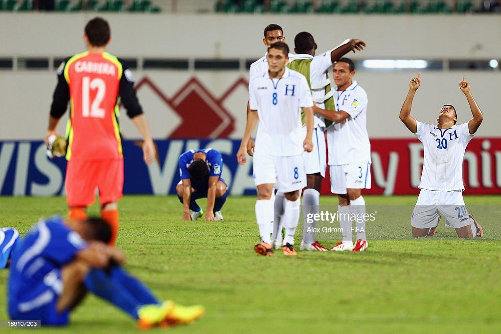 Kevin Lopez (R) of Honduras celebrates after the FIFA U-17 World Cup UAE 2013 Round of 16 match between Honduras and Uzbekistan at Sharjah Stadium on October 28, 2013 in Sharjah, United Arab Emirates.