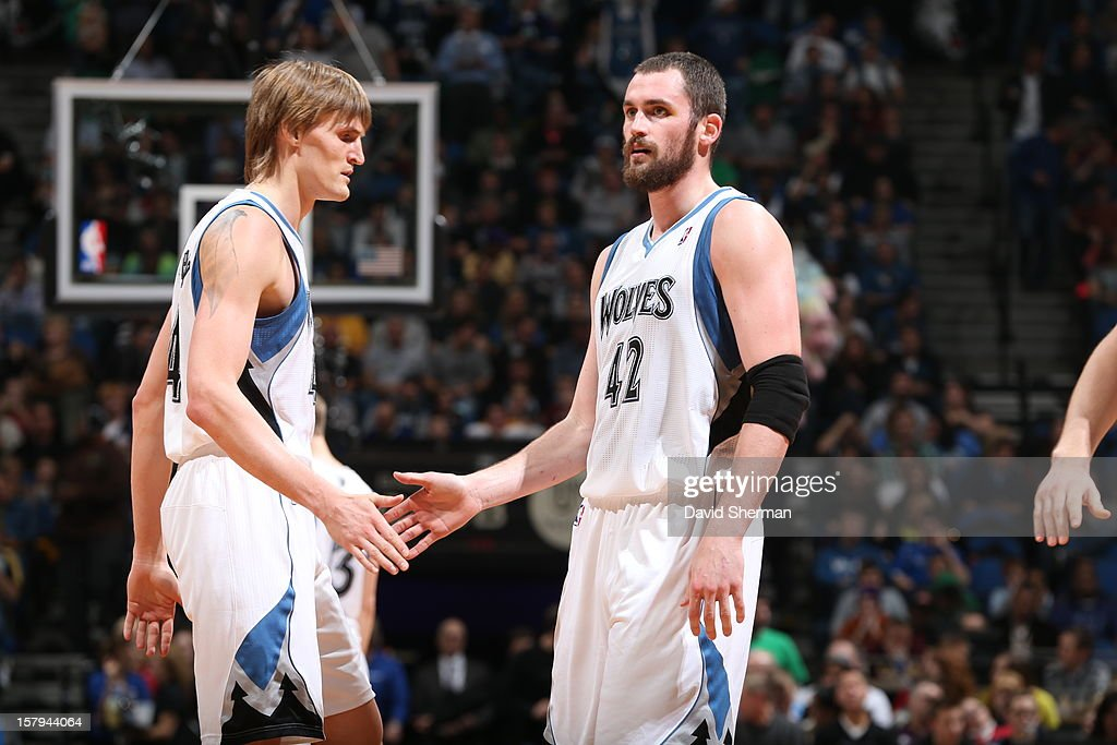 Kevin Love and Andrei Kirilenko give eachother five # of the Minnesota Timberwolves against the Cleveland Cavaliers during the game on December 7, 2012 at Target Center in Minneapolis, Minnesota.
