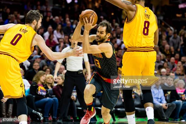 Kevin Love and Channing Frye of the Cleveland Cavaliers guard Jose Calderon of the Atlanta Hawks during the second half at Quicken Loans Arena on...