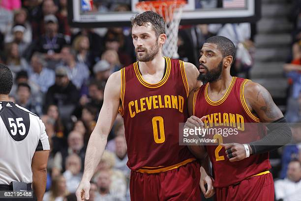 Kevin Love and Kyrie Irving of the Cleveland Cavaliers look on during the game against the Sacramento Kings on January 13 2017 at Golden 1 Center in...