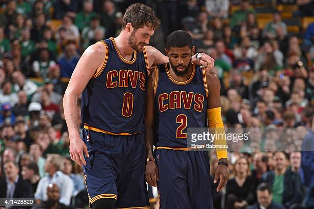 Kevin Love and Kyrie Irving of the Cleveland Cavaliers talk in the game against the Boston Celtics during Game Four of the Eastern Conference...