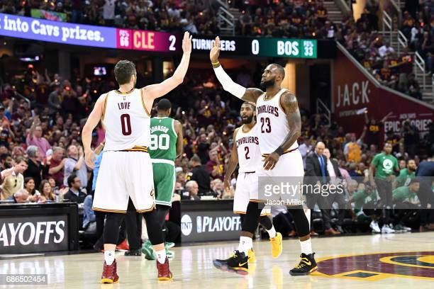 Kevin Love and LeBron James of the Cleveland Cavaliers celebrate in the first half against the Boston Celtics during Game Three of the 2017 NBA...