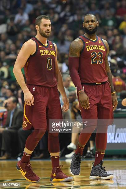Kevin Love and LeBron James of the Cleveland Cavaliers walk backcourt during the first quarter of a game against the Milwaukee Bucks at the Bradley...